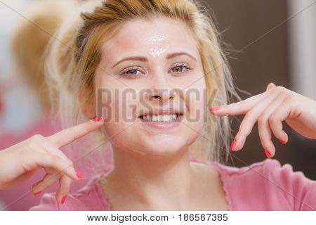 Young Woman Having Gel Mask On Face