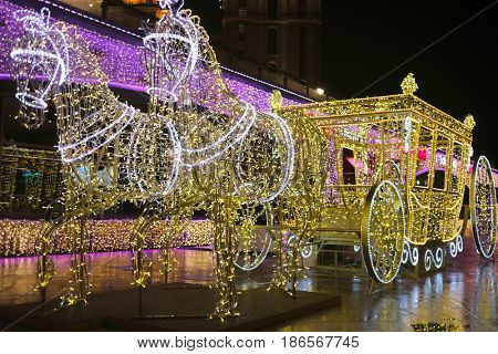 MOSCOW - JAN 1, 2017: Horses and carriage - illumination New Year installation on street, Moscow spent almost 127 billion dollars for New Year decoration of city
