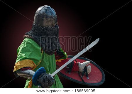 Knight in armour on a dark background