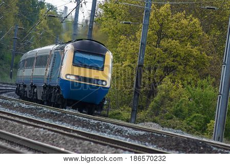 Diesel powered passenger train in motion on the railway