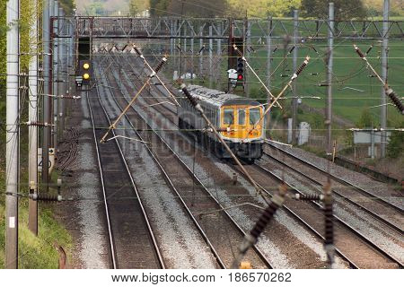 Electric passenger train in motion on the railway