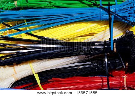 Mix of colorful cable ties tied up in individual colors. Can be used as a background for text.
