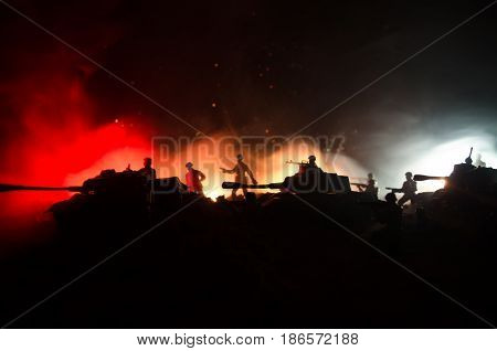 War Concept. Military silhouettes fighting scene on war fog sky background World War Soldiers Silhouettes Below Cloudy Skyline At night. Attack scene. Armored vehicles. Tanks battle