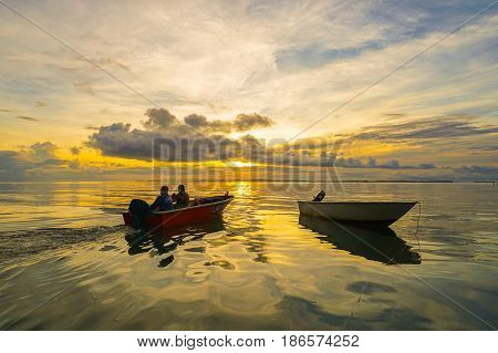 Labuan,Malaysia-May 13,2017:Traditional fisherman with fishing boat in the morning at Labuan island,Malaysia.Aquaculture industry has growth,to contributes the economy of Labuan.