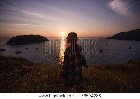 young freedom woman enjoy ocean sunset on mountain peak.