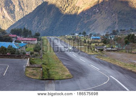 Lukla/nepal - October 18, 2015: Small Airplane Landing In The Tenzing-hillary Airport In Lukla, Hima