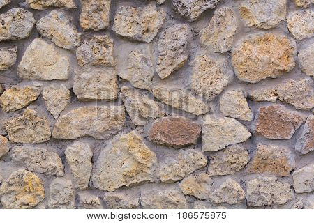Background. Wall Of Broken White Stone