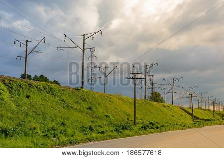 The Electrified Railway Goes Into The Distance Against A Blue Sky