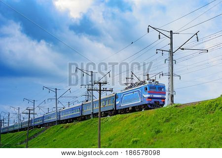 The Train Travels To A Meeting From The Zone With Gray Clouds