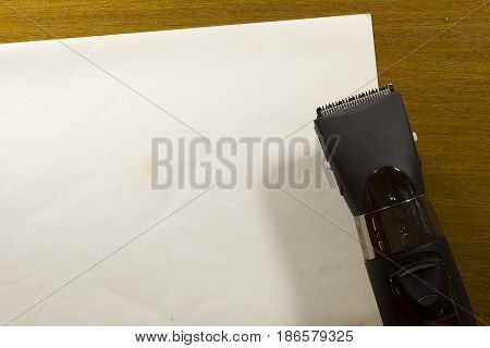 Hair clipper style on the wooden background