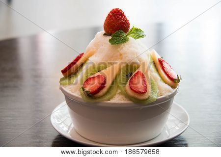 ice milk Korean dessert bingsu with strawberry kiwi and melon