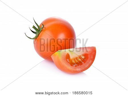 whole and portion cut fresh tomato on white background