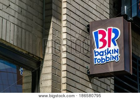 New York May 08 2017: Baskin Robbins sign is attached to exterior wall over the entrance to one of their retail stores in Manhattan.