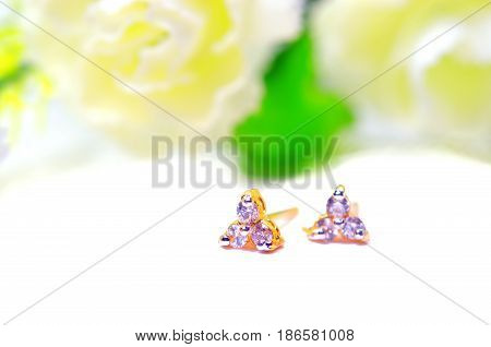 Gold Pendant Cameo Jewelry And Three Diamond Gems With Flowers Putting Isolated On White