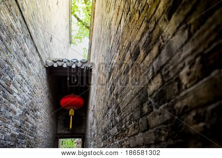 narrow brick wall with Chinese red lamp ancient wall of China village park