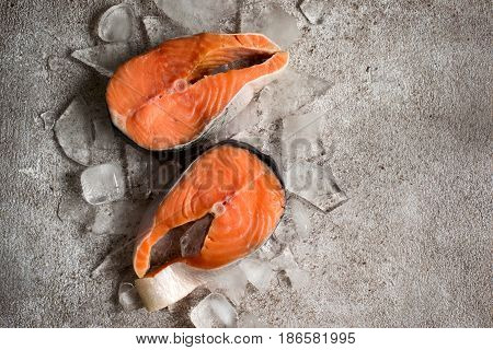 Fresh salmon fish. Raw salmon steaks on ice. Food background. Top view with copy space