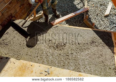 Pouring cement for pavement laid from the house to the road