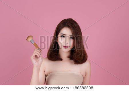 Short Hair Asian Young Beautiful Woman Applying Cosmetic Powder Brush On Smooth Face Isolated Over P