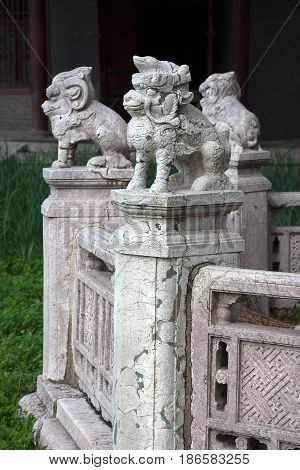 Shenyang, China - July 20, 2013: Cracked sculptures of mythical animals in Beiling Park, not far from Zhaoling Tomb of the Qing Dynasty