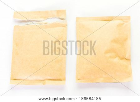 Brown Paper And Torn Paper Food Package On White