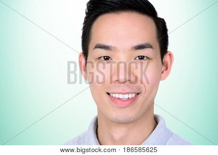 Portrait of smiling young Asian man - close up