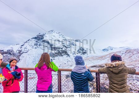 ICELAND - MARCH 15, 2017: Unidentified people at Beautiful famous waterfall in Iceland, winter season