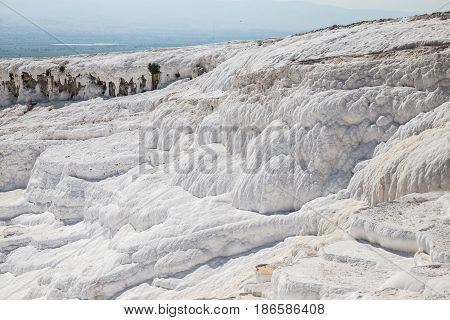 White limestone terraces and hot thermal pools in Pamukkale, Turkey