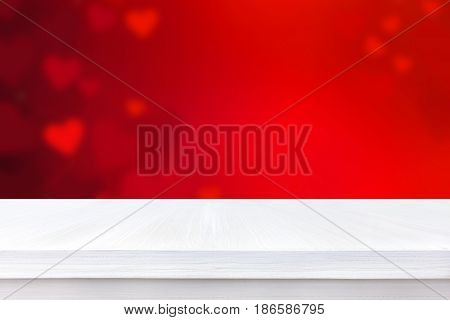White wood table top on blur red heart abstract background love and Valentine's day background concept