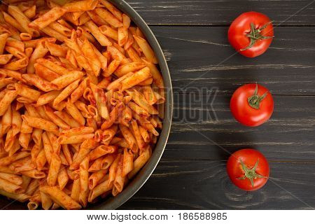 Penne pasta with tomato sauce in pan