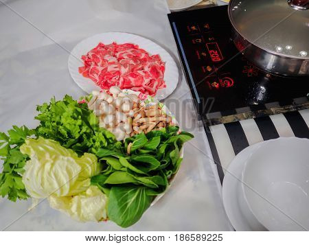 Sliced beef and vegetables with hot pot set ready to serve for shabu menu