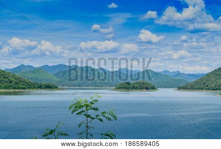 Panorama view of mountain terrain in the dam with clear blue sky background peace and relaxation concept.