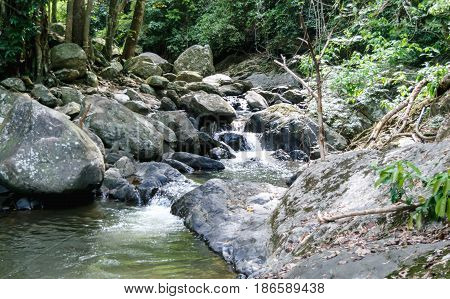 Landscape view of water stream near waterfall in summer Thailand trekking and hiking concept.