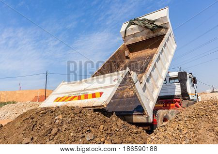 Truck Tipping Earth Construction