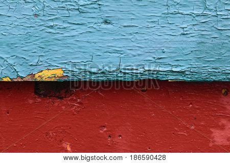 Contrasting background divided into two halves horizontally the top one - wooden painted blue and cracked the bottom one - concrete painted with red paint