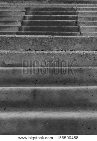 Steps of gray concrete stairs reaching up close-up