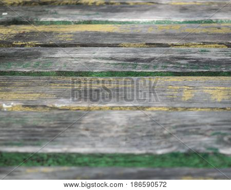 Background of old wood with traces of old paint and green with moisture iest