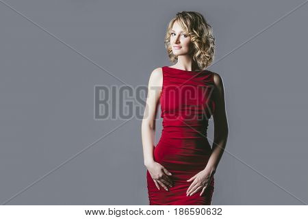 Beautiful Woman Blonde Model In Red Dress A Fashionable And Elegant