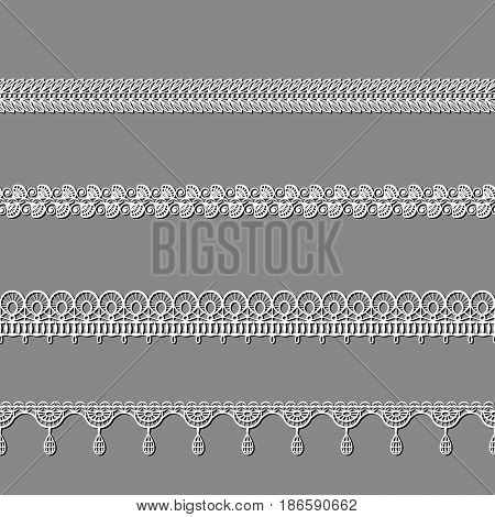 set of white lace ribbons on a grey background