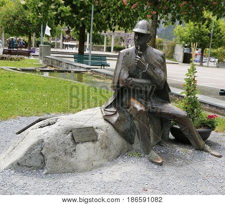 MEIRINGIEN, SWITZERLAND - MAY 6, 2017: Statue of Sherlock Holmes in front of the Sherlock Holmes Museum in Meiringen, Switzerland