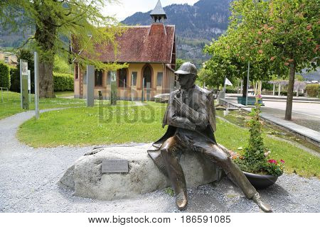 MEIRINGIEN, SWITZERLAND - MAY 6, 2017: Statue of Sherlock Holmes in front of the Sherlock Holmes Museum in Meiringen, Switzerland