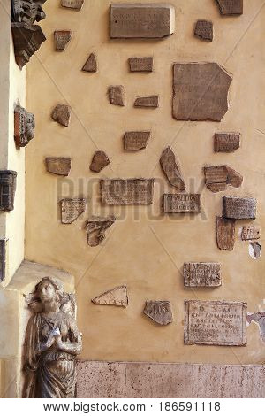marble bas-relief of the sculpture and marble nameplates on the wall in the Italian courtyard