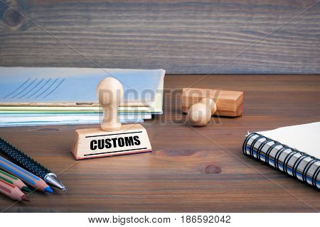 Customs. Rubber Stamp on desk in the Office.