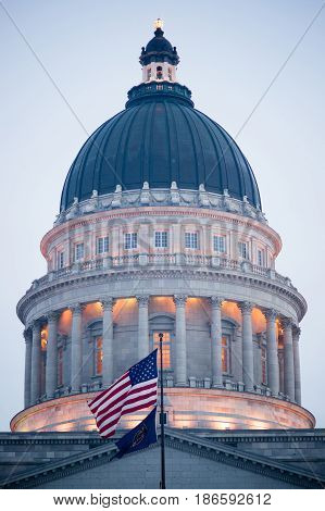 The US and Utah Flags fly in front of the State Capital in Salt Lake City