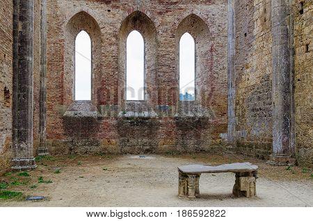 Gothic windows behind the altar of great Abbey of Saint Galgano - San Galgano Tuscany Italy
