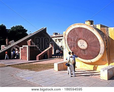 JAIPUR, INDIA - NOVEMBER 24, 1993 - People looking at the giant sundial known as the Samrat Yantra at Jantar Mantar Jai Singhs Observatory Jaipur Rajasthan India, November 24, 1993.