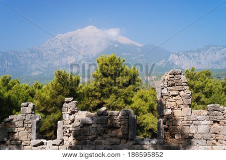 Ruins of ancient city of Phaselis. Historical place on the Lycian trail. View of Tahtali mountain. Tourist attraction of Turkey. Location near the village of Tekirova in the Kemer area