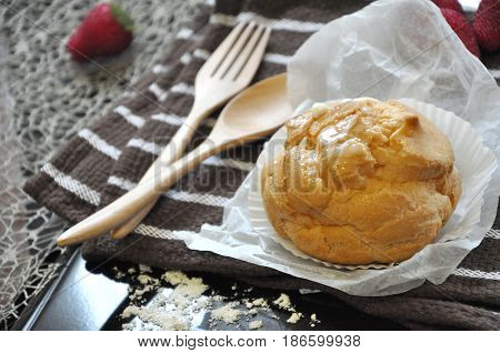 Close up Choux cream with wooden spoon and fork on background