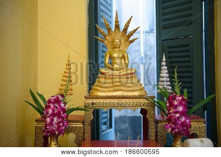 One style of Buddha image with a naga over head.