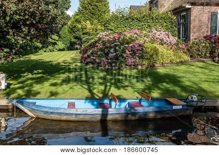 Giethoorn Netherlands - August 5 2016: The village Giethoorn is unique in the Netherlands because of its bridges waterways and typical boats calle punters. It is also called the Venice of Holland