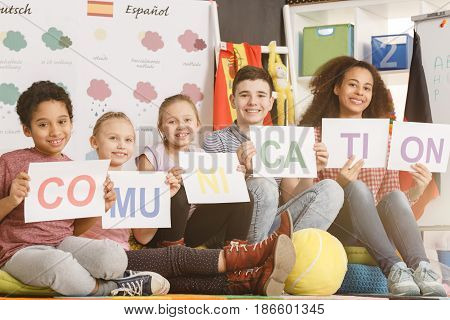 Woman And Kids Holding Communication Inscription
